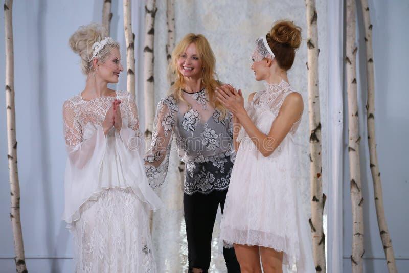 Elizabeth Fillmore and models walks the runway during the Elizabeth Fillmore Fall/Winter 2016 Couture Bridal Collection. NEW YORK, NY - OCTOBER 13: Elizabeth royalty free stock photo