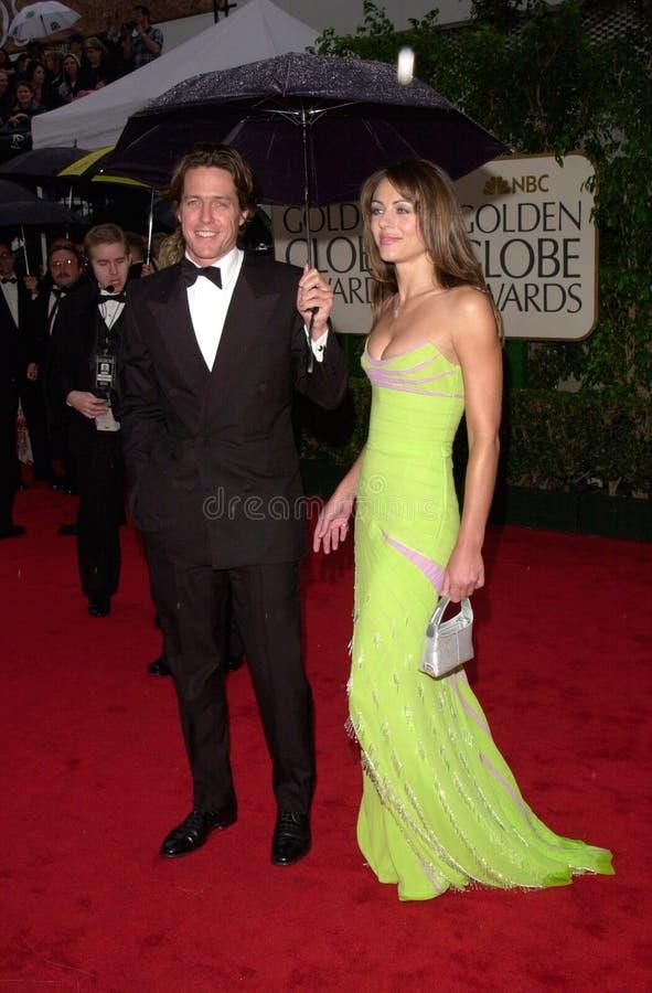 Elizabeth Hurley,Hugh Grant. 23JAN2000: Actor HUGH GRANT & actress girlfriend ELIZABETH HURLEY at the Golden Globe Awards in Beverly Hills. Paul Smith / royalty free stock image