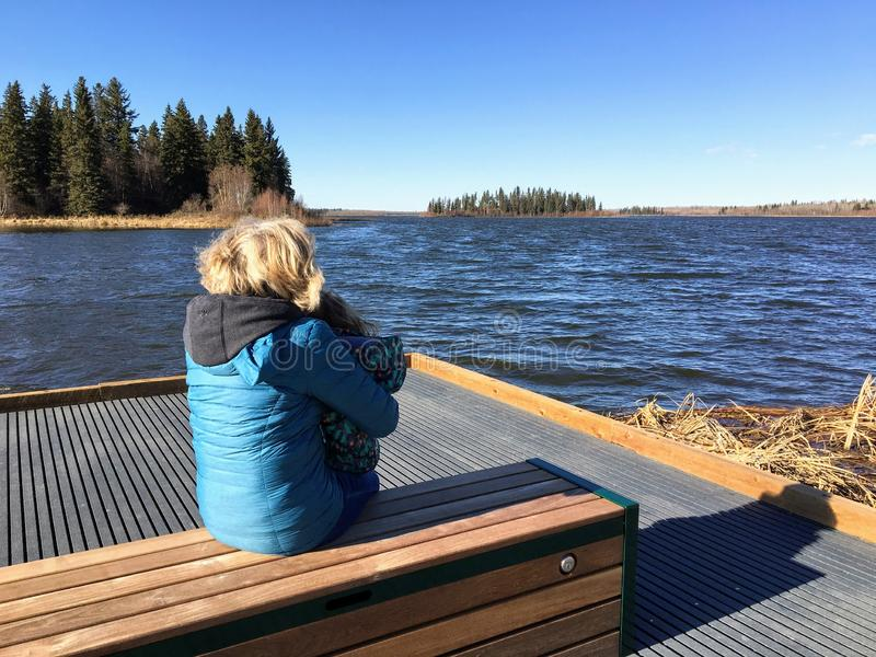 A woman and her granddaughter enjoying the views of the beautiful Astotin lake in Elk Island stock photo