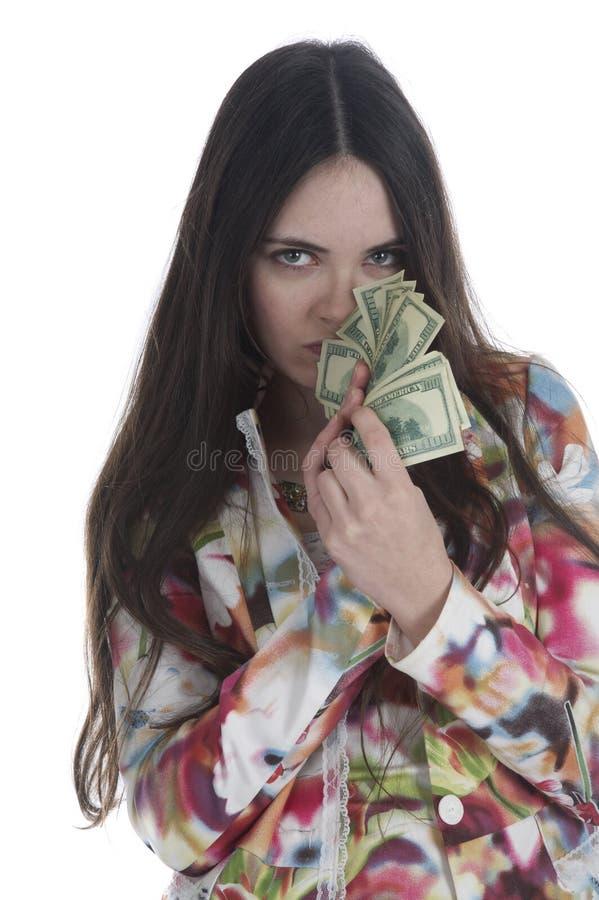 Elle retient l'argent photo libre de droits