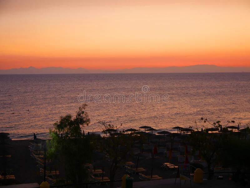 Sunset over Ellie Beach which is the nearest beach to Rhodes Town and is popular with locals and tourists alike royalty free stock photography