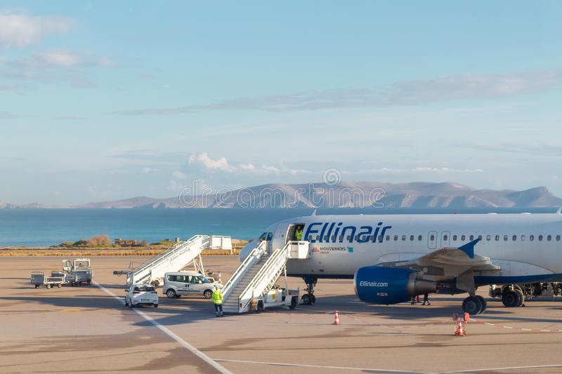 Ellinair airplane preparation for takeoff loading cargo stock photos