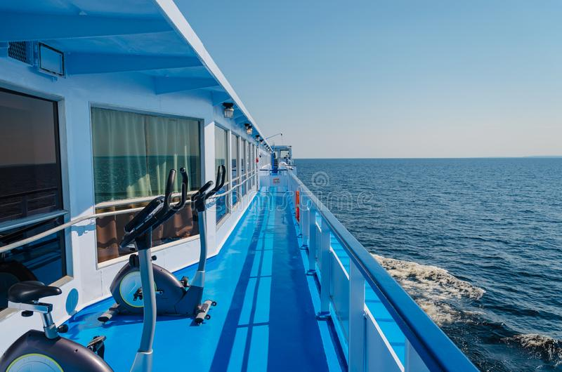 Elliptical cross trainer on the deck of a cruise ship. Summer sunny day royalty free stock image