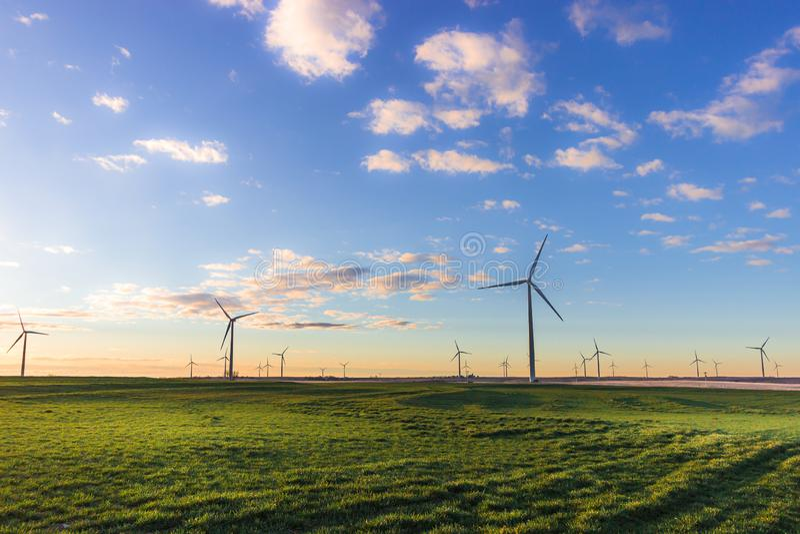 Ellis County, KS USA - Windmill Park in the Kansas Prairie on a Crisp Spring Morning. Windmill Park in the Kansas Prairie on a Crisp Spring Morning. Cloudy sky royalty free stock photos