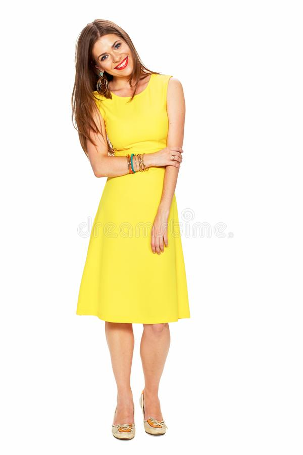 Ellow dress. White background. Young woman fashion style portra royalty free stock image