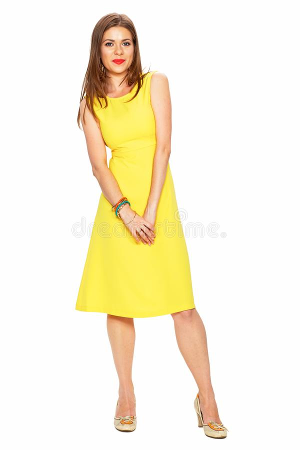 Ellow dress. White background. Young woman fashion style portra royalty free stock photography