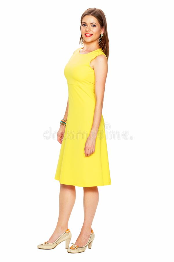 Ellow dress. White background. Young woman fashion style portra stock image