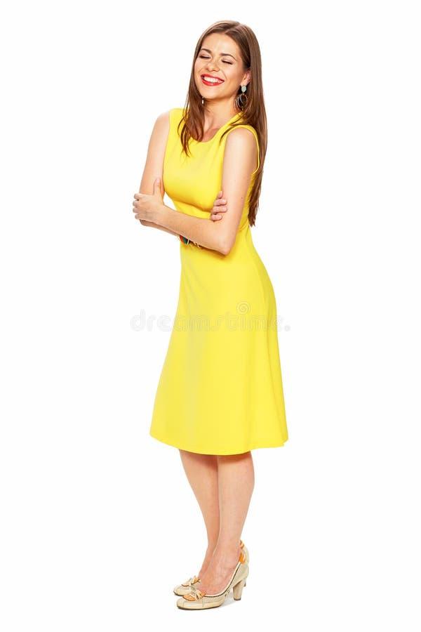 Ellow dress. White background. Young woman fashion style portra stock photos