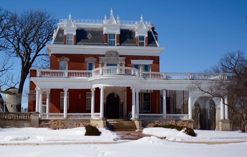 Ellwood Mansion in Snow. This is a Winter picture of the Issac Ellwood Mansion in Dekalb, Illinois. The home of the barbed wire magnate was designed by George O stock photos
