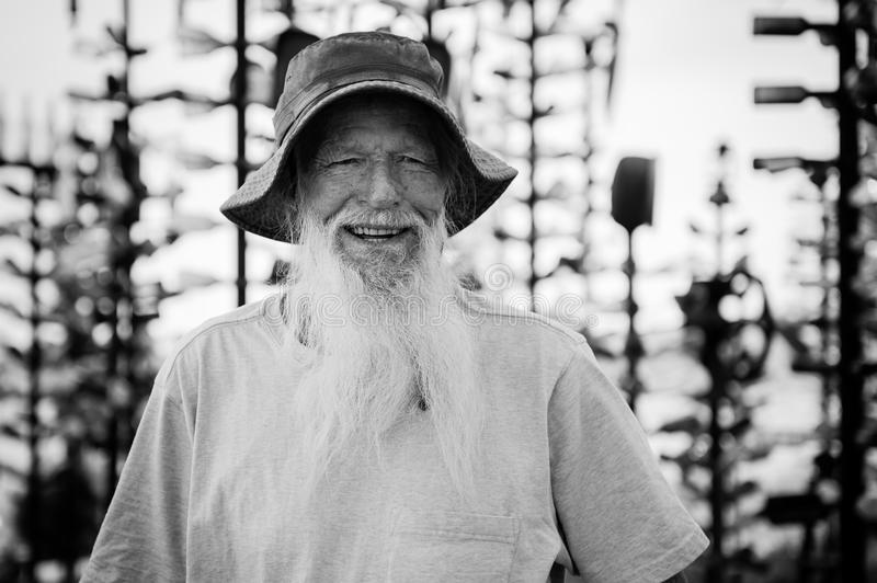 Elmer - the owner of the Bottle Tree Ranch on Route 66. Idyllic american face. Elmer's Bottle Tree Ranch is literally a forest of bottle trees large stock photo