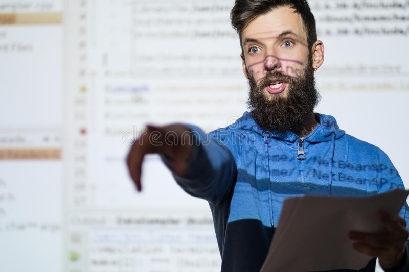 Elocution speech craft orator interact discussion. Elocution or speech craft courses. Bearded young male orator interacts with someone in the audience pointing a royalty free stock photo