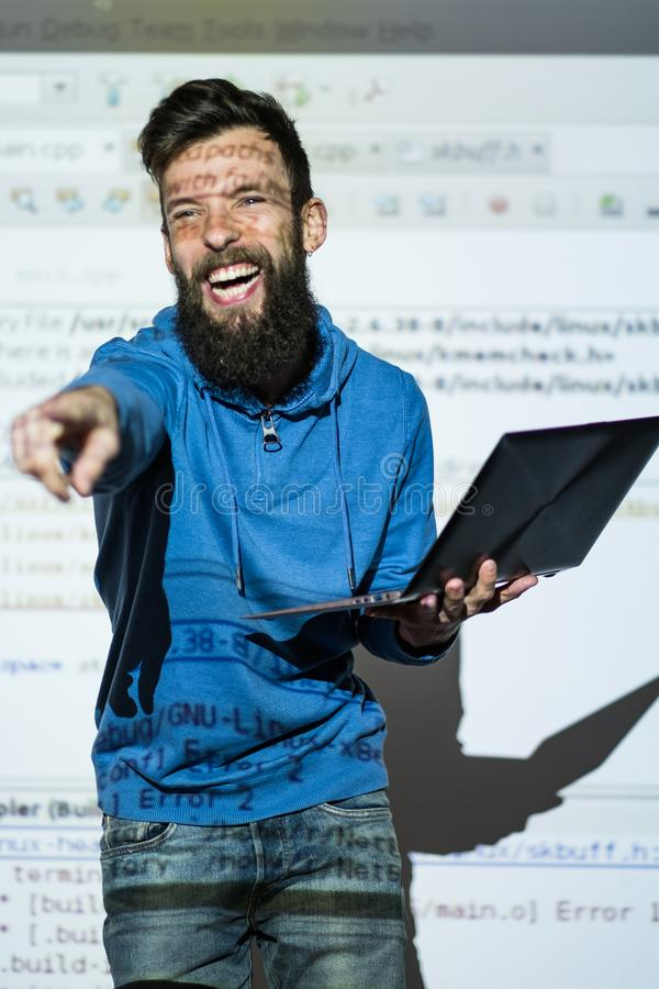Elocution speech craft orator interact laugh. Elocution or speech craft courses. Bearded young male orator laughing and interacting with someone in the audience stock photos