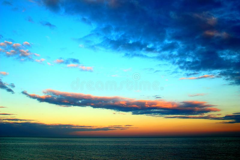 Elongated cloud in the sky. Over the Adriatic sea during sunset stock images