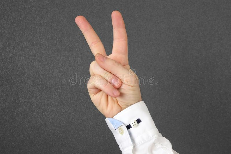 Elongated male hand with two fingers. The Elongated male hand with two fingers royalty free stock photography