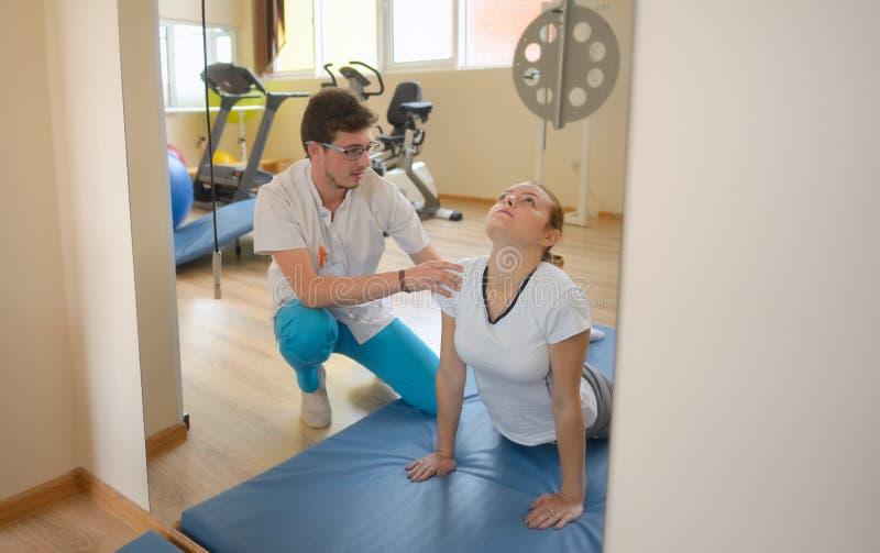 Elongation treatment of low back pains stock images