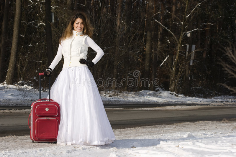 Eloping bride with bag royalty free stock photos