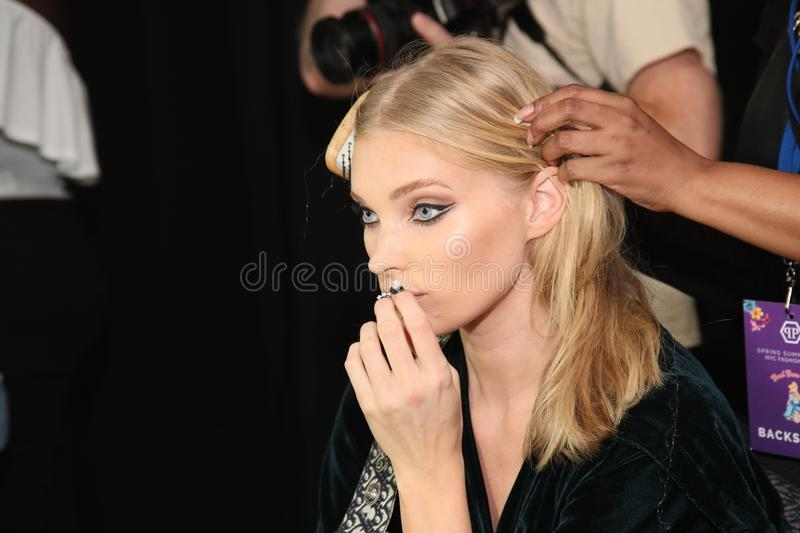 Elsa Hosk getting ready backstage for the Philipp Plein fashion show royalty free stock photography