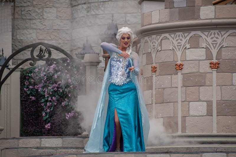 Elsa on Mickey`s Royal Friendship Faire on Cinderella Castle in Magic Kingdom at Walt Disne stock photography