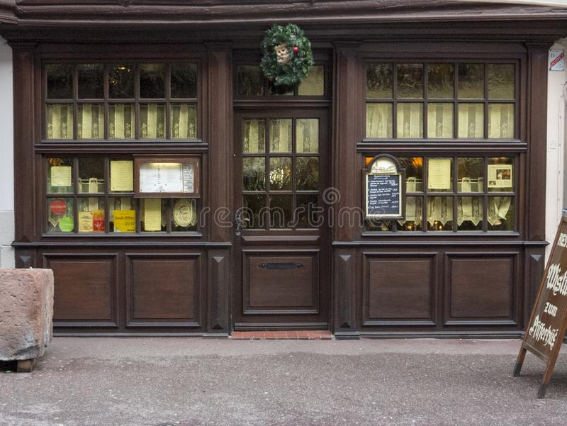ELSAS, FRANCE - December 28, 2017: Christmas Eve - a wooden showcase of an old restaurant decorated for the holiday stock photos
