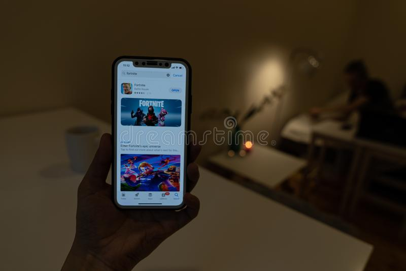 Elva, Estonia November 15, 2018 girl holding iphone with online Fortnite game Epic games in app store on display.  stock photo