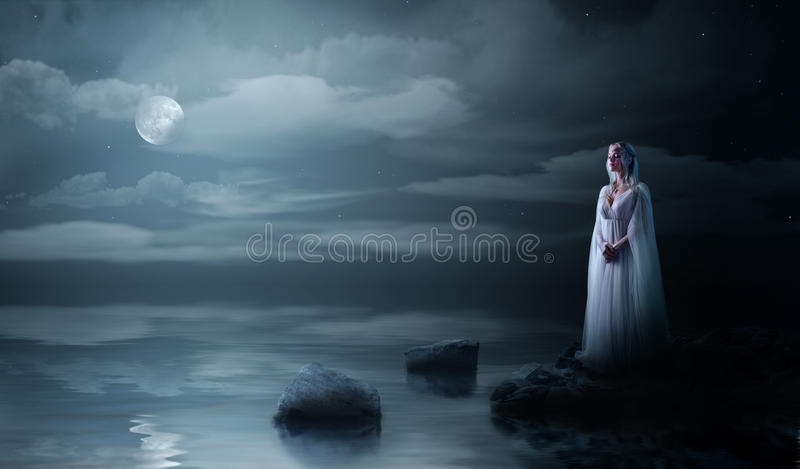 Elven girl on sea coast stock photos