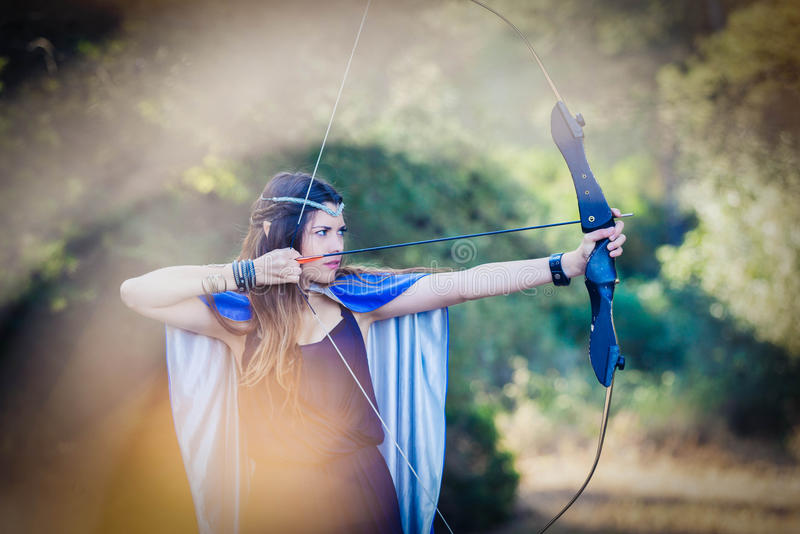 Elven wood princess with bow and arrow stock image