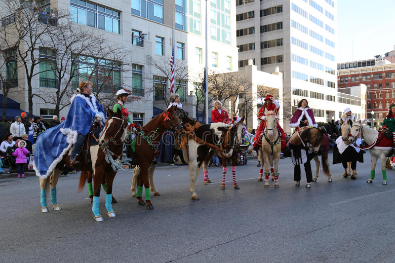 Elves on Horses in Parade. Harrisburg, PA - November 21, 2015: Elves on horses on the downtown street in the City of Harrisburg during the annual Holiday Parade royalty free stock images