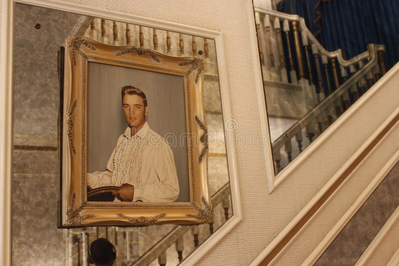 Elvis Presley Graceland. Staircase at Graceland with framed picture of Elvis Presley
