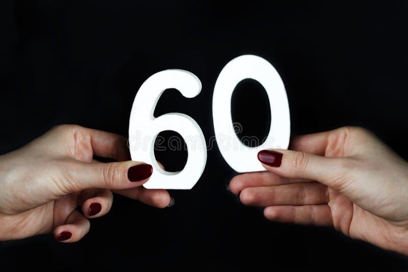 Em figura fêmea sessenta das palmas imagem de stock