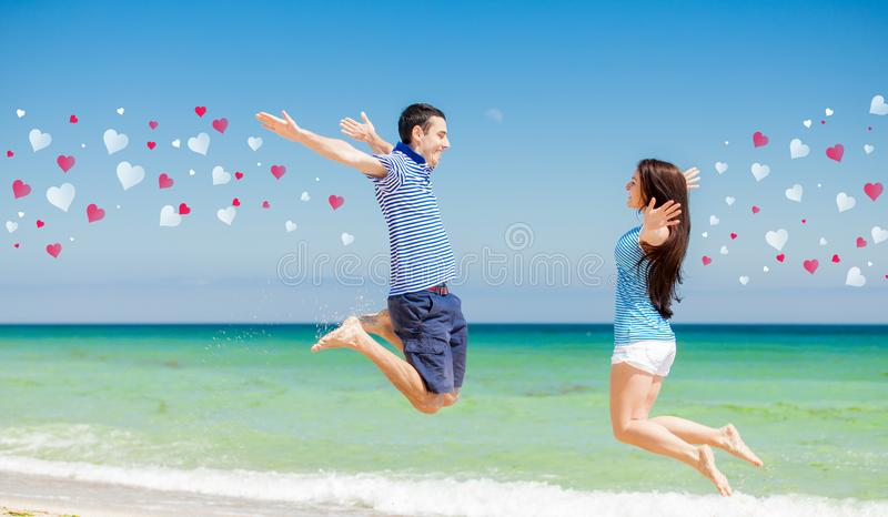 Em pares do amor na roupa azul que salta entre si imagem de stock royalty free