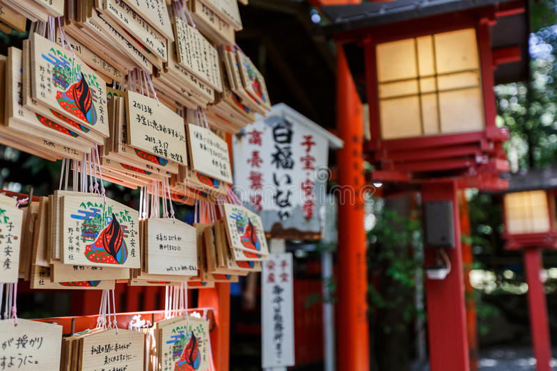 Ema at Arashiyama. Ema (Shinto) are small wooden plaques on which Shinto worshippers write their prayers or wishes. Ema are sold for various wishes. At stock photography