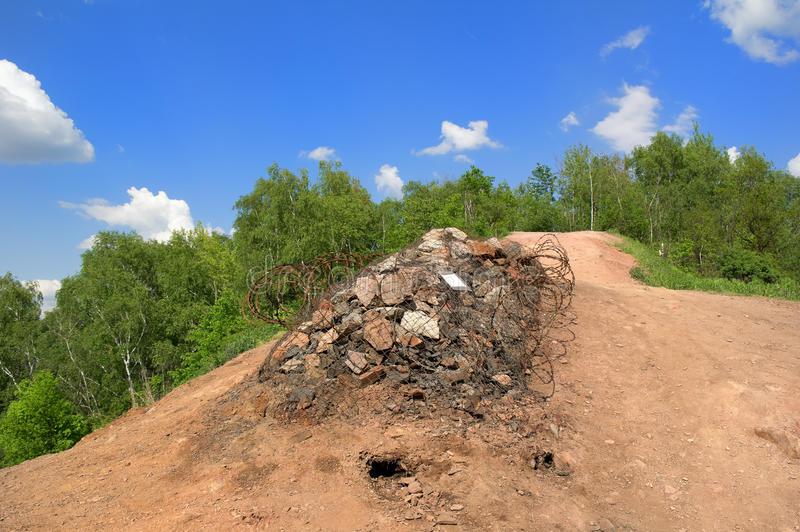 Ema mound in Ostrava. Ema mound (halda Ema), Ostrava, Czech republic. Artificial hill made by collecting debris from mining. Despite danger and prohibition it's royalty free stock photography