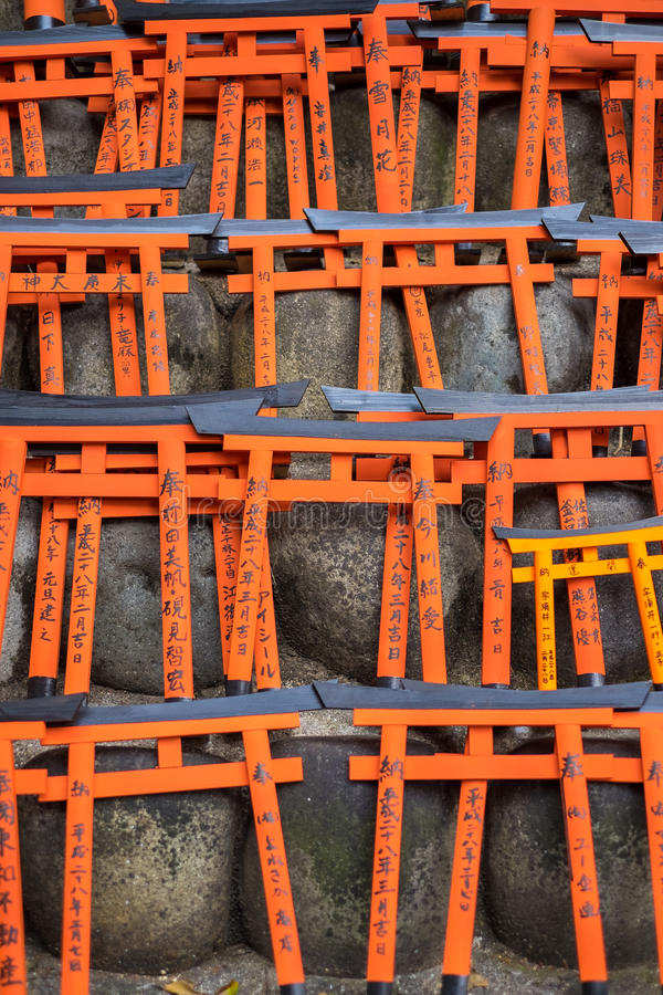 Ema prayer tables with unique Torii gates boards at Fushimi Inari Taisha Temple. KYOTO, JAPAN - MARCH 24, 2016 : Ema prayer tables with unique Torii gates boards stock images