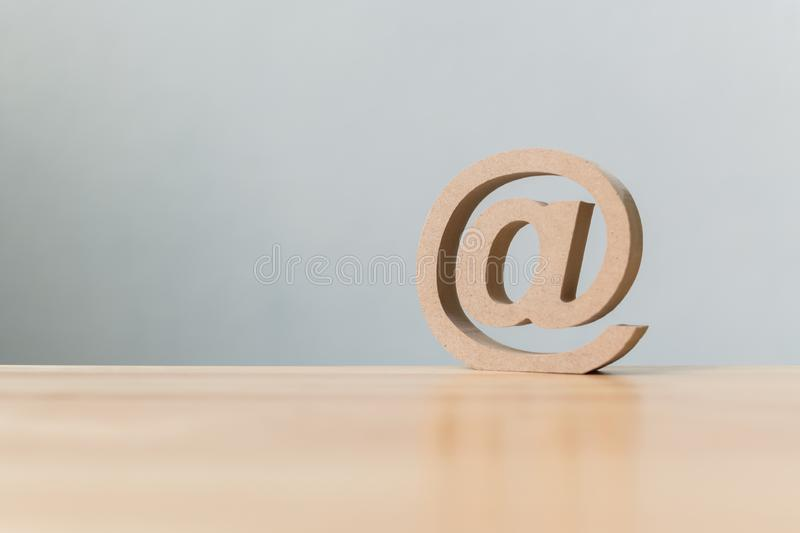Email address icon wooden symbol, Contact us customer service by royalty free stock photography