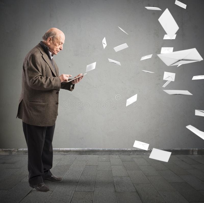 Email as old letters. Old man send email from his tablet stock photos