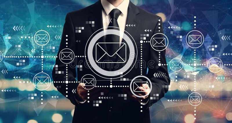 Email concept with businessman holding a tablet royalty free stock images