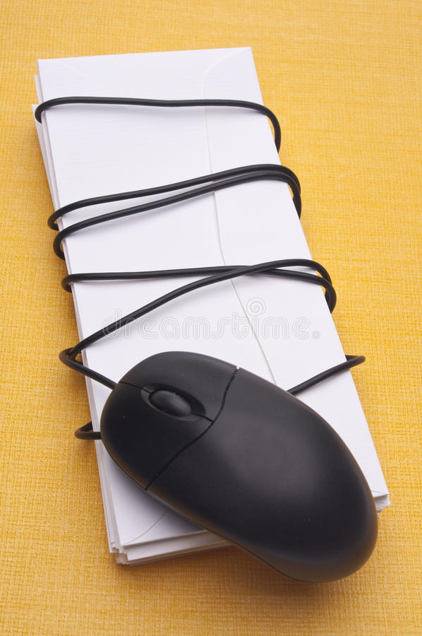 Email Concept Image. With Computer Mouse Wrapped Around a Stack of Letters royalty free stock photos