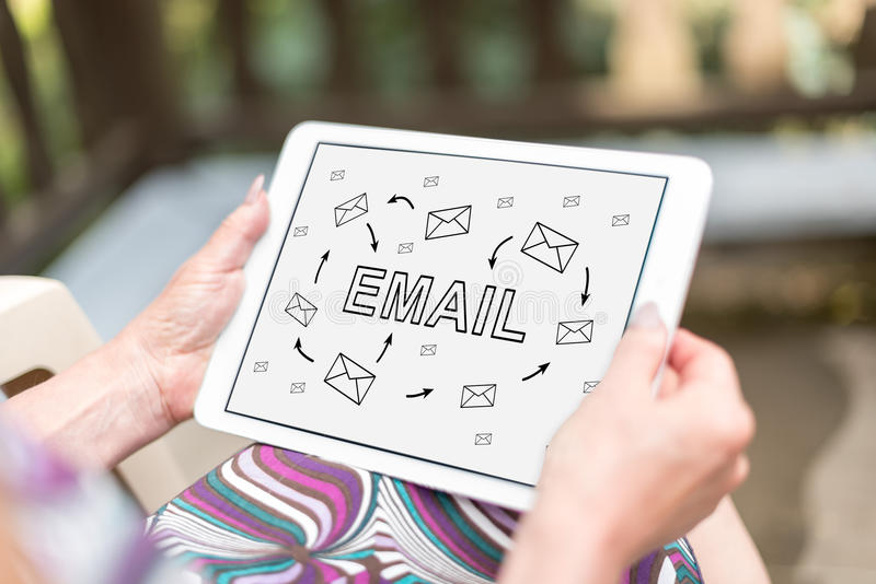 Email concept on a tablet. Email concept shown on a tablet held by a woman royalty free stock photo