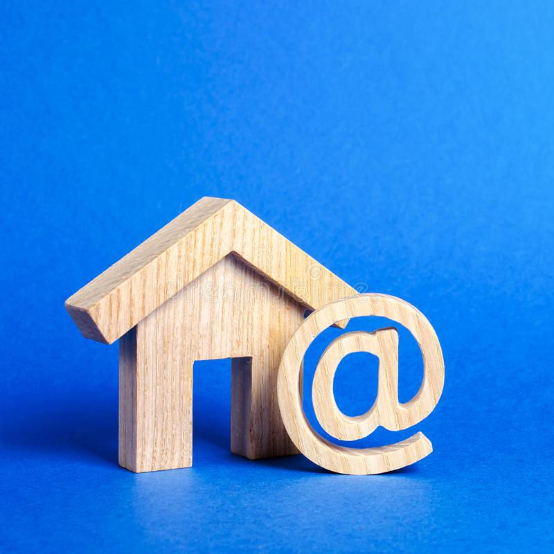 Email icon and house. Contacts for business, home page, home address. communication on Internet. Internet and global communication. Digitalization of economy royalty free stock photography