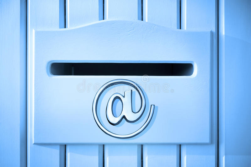 Email Mailbox Mail Technology. A mailbox built into a picket fence with an email at sign on the front stock image