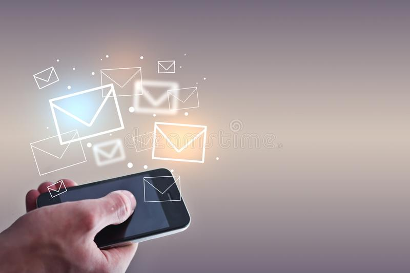 Email marketing concept. Businessman holding smartphone with emails on light background. Email marketing concept