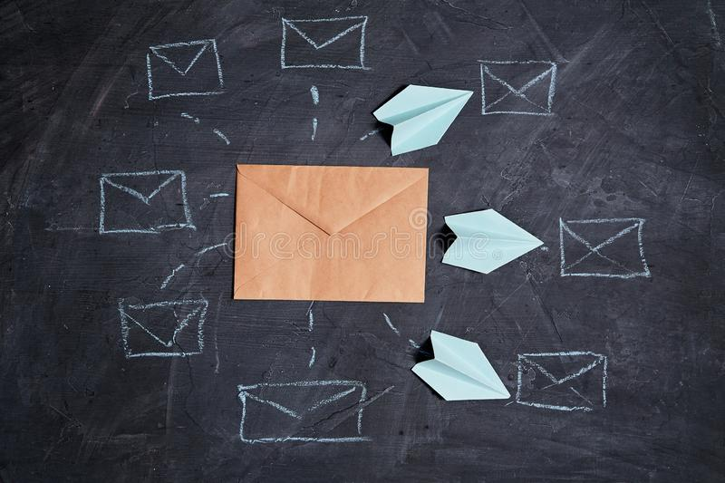 Email marketing and message online, mail communication and e-commerce concept: Paper planes flying to mailbox symbols royalty free stock images