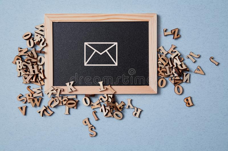 Email marketing and message online. Wooden letters and chalkboard royalty free stock images