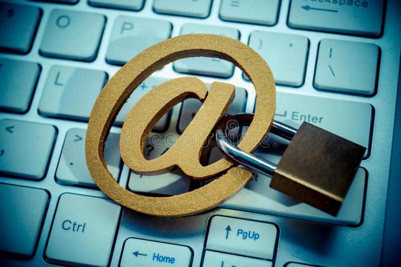 Email security. Email sign with a padlock on computer keyboard. Email security and countermeasure concept stock image