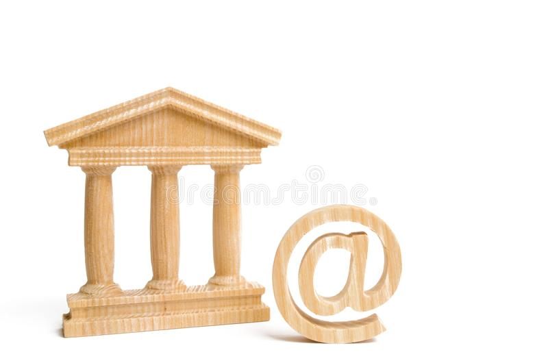 An email symbol and a bank building or government. Introduction of electronic tools and technologies in the state and banking syst. Ems. Contacts of state stock image