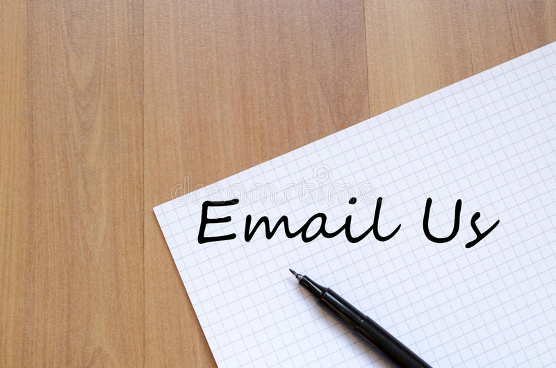 Email us write on notebook royalty free stock image
