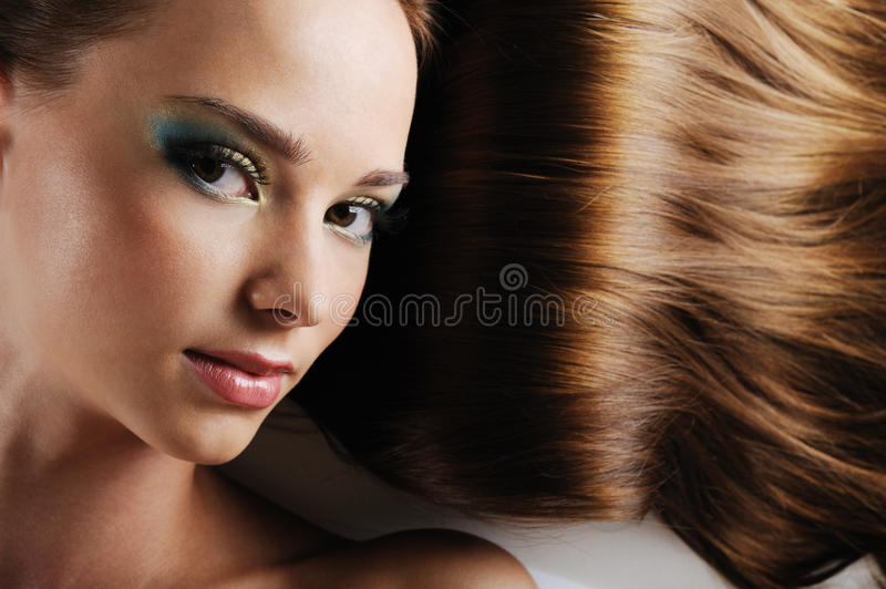 Download Emale Face With Brown Hairs As A Background Stock Photo - Image: 14995862