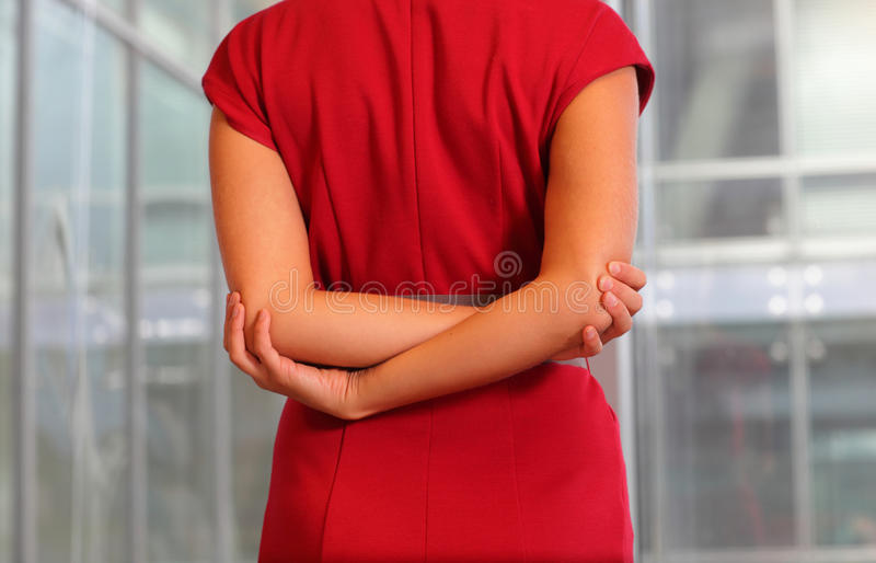 Emale in red dress stretching arms royalty free stock image
