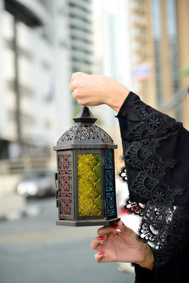 Emarati Arab woman holding Ramadan lantern stock photography