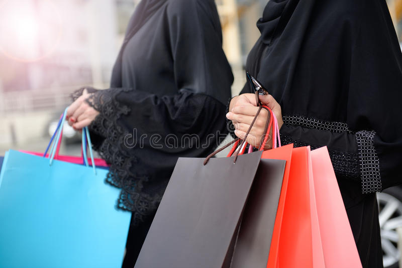 Emarati Arab women coming out of shopping stock image